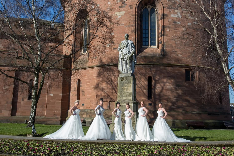 Wedding dresses being displayed in a Carlisle park.