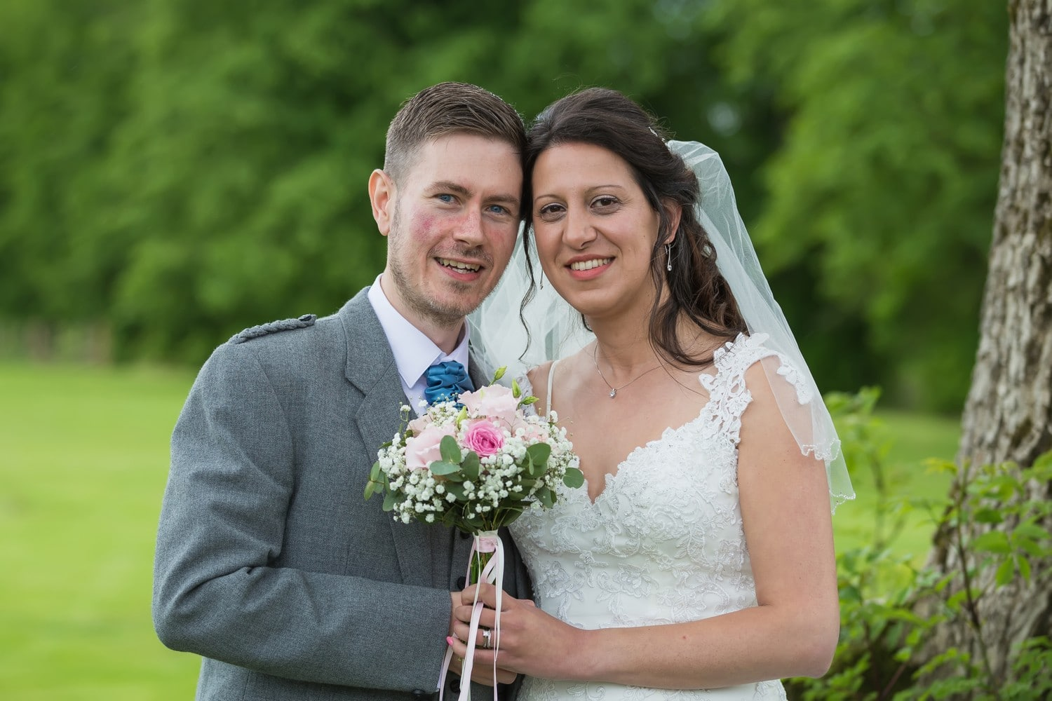 Bride and Groom with flowers near Gretna