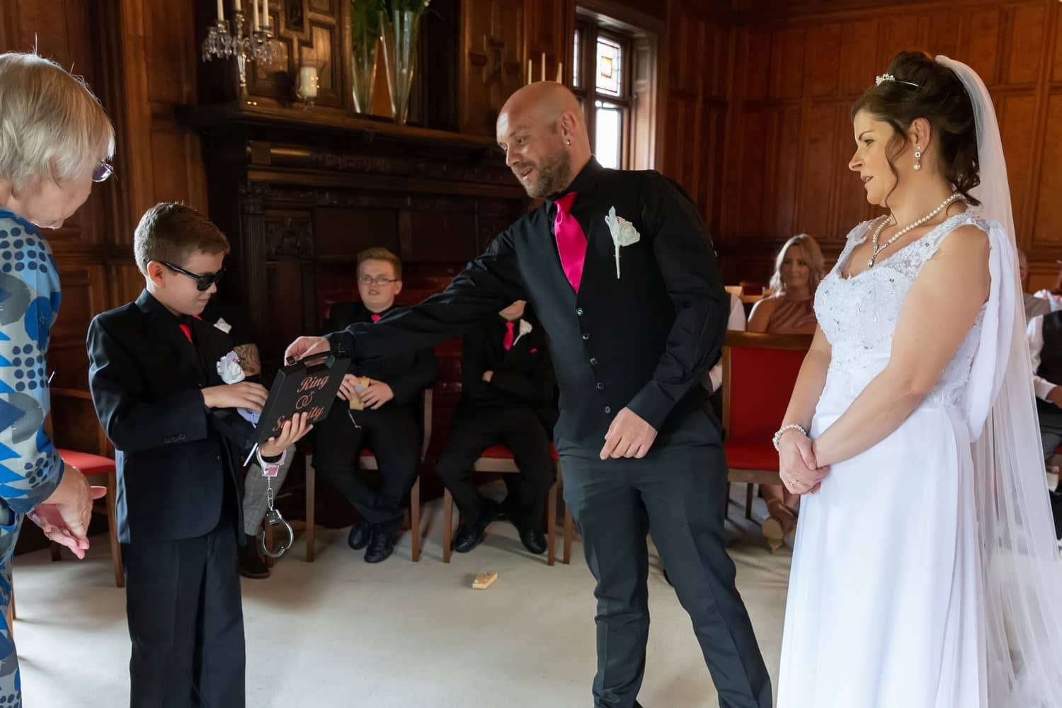 Groom takes a ring from the ring bearer at Carlisle Registry Office