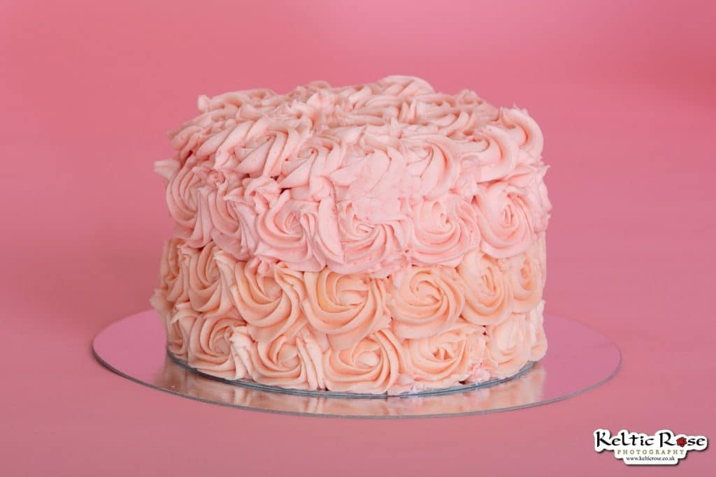 Pink birthday cake for a cake smash photo session
