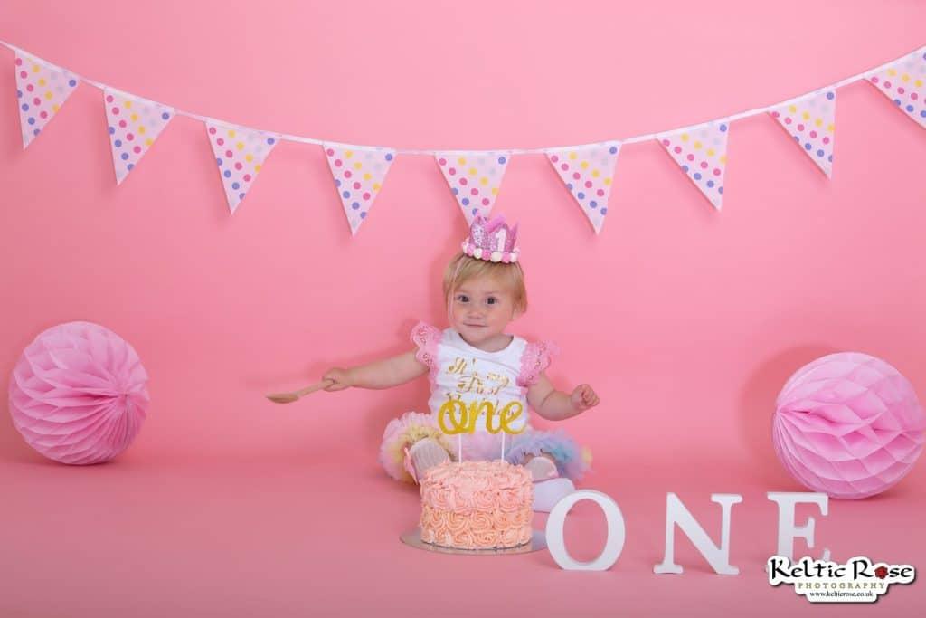Carlisle girl from cake at a cake smash photo session