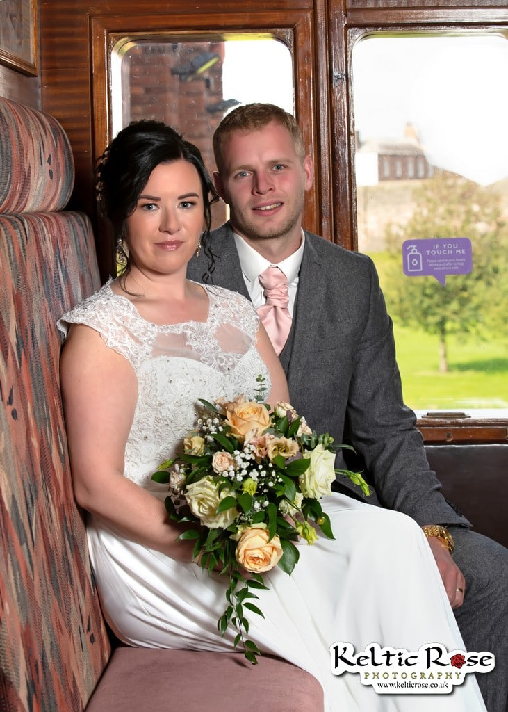 Bride and Groom with Flowers in a railway carriage in Tullie House Carlisle