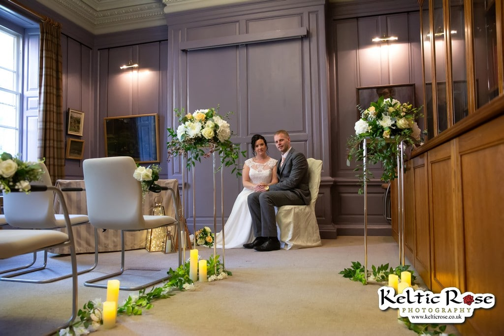 wedding couple seated at Tullie House Museum and Art Gallery