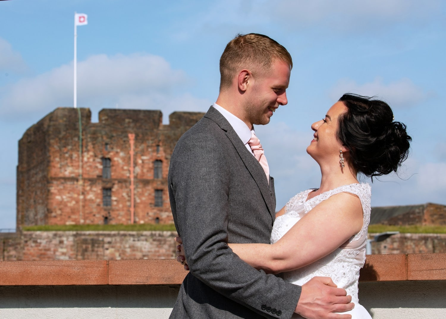 Carlisle Castle with Bride and Groom in front. taken from Tullie House Museum